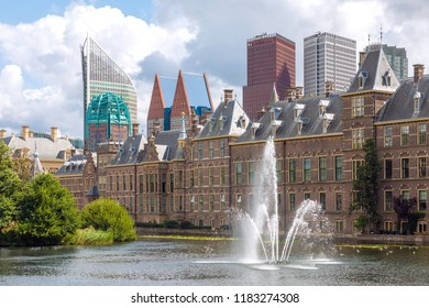 City center view of The Hague in Netherlands with pond Hofvijver and historical Binnenhof in foreground and modern skyscrapers in bakground