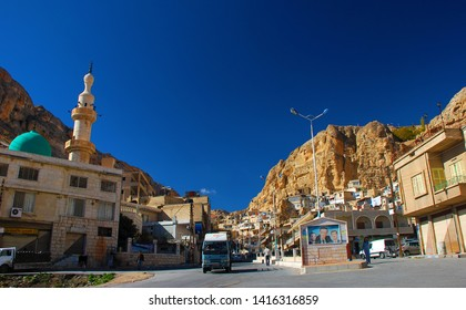 City Center View Maaloula with portraits of the Assad family. Only here and in two other cities are spoken aramaic language. Syria before the war. Maaloula, Syria, Middle East. November 23, 2007.