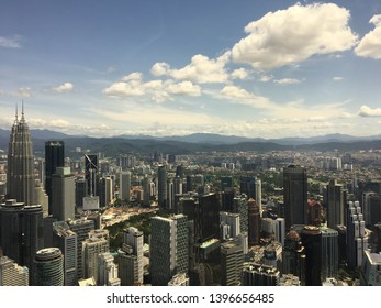 City Centre, Kuala Lumpur, Malaysia - Jan 23rd, 2019: The view from the top of Kuala Lumpur Tower (KL Tower) and its Surroundings with clear blue sky and white cloud during the afternoon