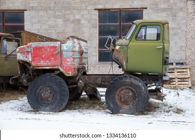 City Cesis, Latvia. Old damage cars in industrial park.  Rubber an iron. Travel urban street photo 2019. 2 March.