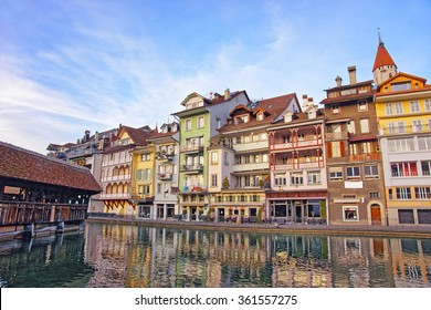The City Church and Old Wooden Bridge at the Embankment in the Old City of Thun. Thun is a city in Swiss canton of Bern. It is located where Aare river flows out of Lake Thun (Thunersee).
