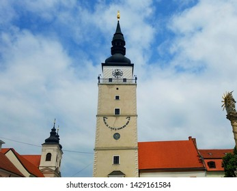 City clock tower in Trnava, Slovakia on a cloudy summer day