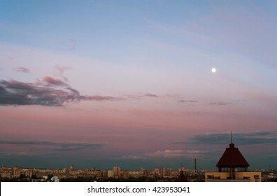 A City Cloudscape with Moon in Evening