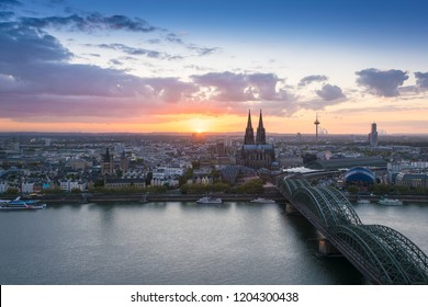 The city of Cologne with its cathedral at dusk