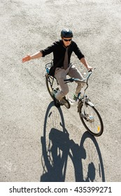 City commuter on electric bicycle, signalling before right turn