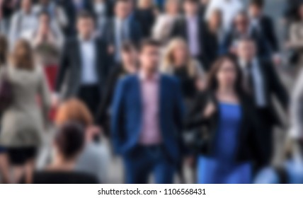 City commuters. Blurred image of workers in generic city. Unrecognizable faces