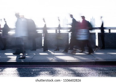 City commuters. High key blurred image of workers on London Bridge. Concept for Londoners, modern life, management, corporate, future cities, employment, digital transformation, business, finance