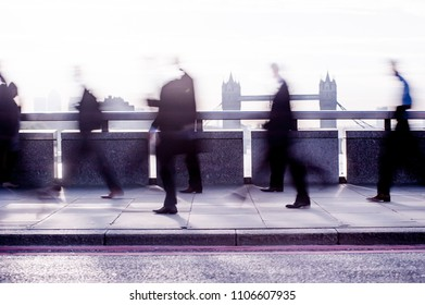 City commuters. High key blurred image of workers on London Bridge. Unrecognizable faces, bleached. London. Concept for Londoners, modern life, management, corporate strategies, finance, business