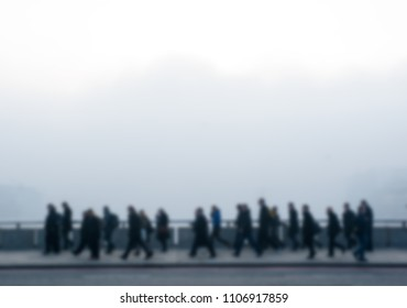 City commuters. Intentionally blurred image of workers in generic city. Unrecognizable faces. Early morning fog in winter. Concept for Londoners, modern life, management, corporate strategies, future