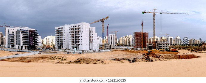 City construction among desert dunes. Building yard of Housing construction of houses in a new area of the city Holon in Israel