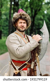 City Cossack 1st half of the 17th century. In a caftan, a fur hat in the hands of birding. A man from the time of Boris Godunov, Russian history. A harsh Russian man.