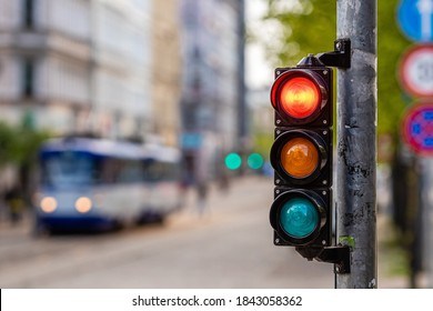 a city crossing with a semaphore, red light in semaphore, traffic control and regulation concept