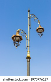 City decorative street lantern on blue sky background. Urban metal lamppost in Marrakesh, Morocco