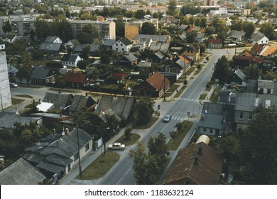 City district, buildings in small town, roads with traffic, Daugavpils, Latvia
