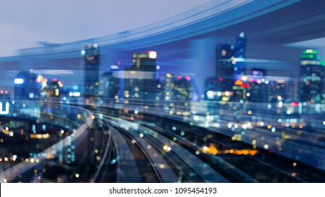 City downtown blurred bokeh light over train track motion double exposure, abstract background