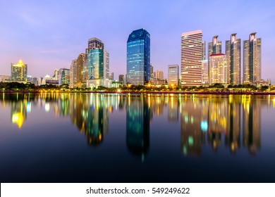 City downtown at night with reflection of skyline, Bangkok,Thailand.
