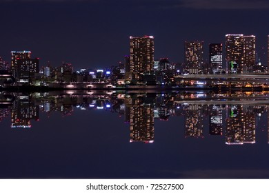 city downtown at night with reflection of skyline