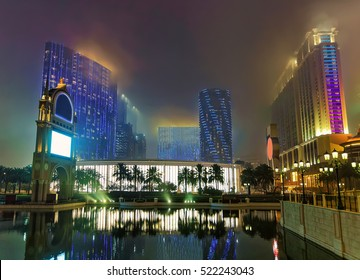 City of Dreams and Canal of Venetian Macau Casino and Hotel luxury resort in Macao, China. Late in the evening. Golden light illumination