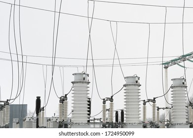 City electrical substation, close-up, transformer with high-voltage wires.