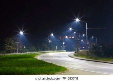 city exit at night with LED streetlights