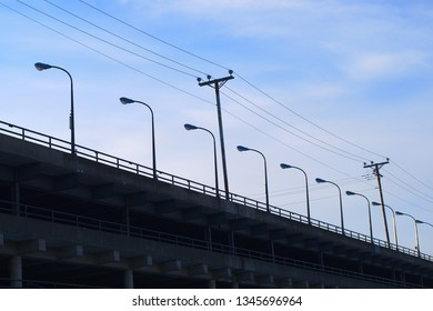 city floor parking lot lights in a row sky electric pole lamps