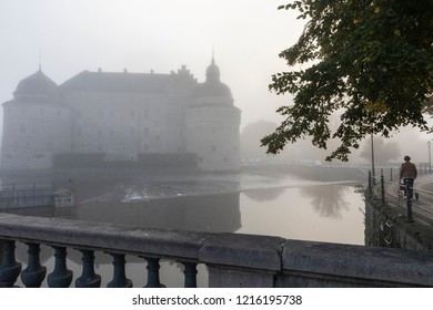City in the fog with woman