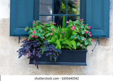 In a city of gardens, a beautiful planter box is seen in the historic district of Charleston, South Carolina, a popular slow travel destination in the southern United States.