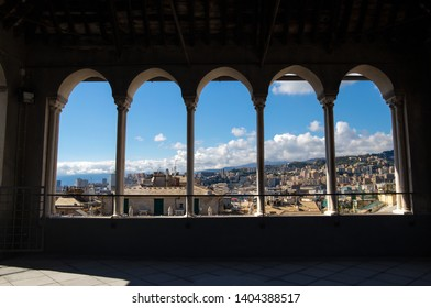 City of Genoa through the colonnade of the Saint Lawrence (San Lorenzo) Cathedral, Genoa, Italy.