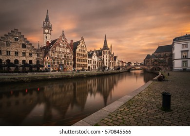 City of Ghent (or Gent) in Belgium at sunset with ancient buildings reflected on the canal.