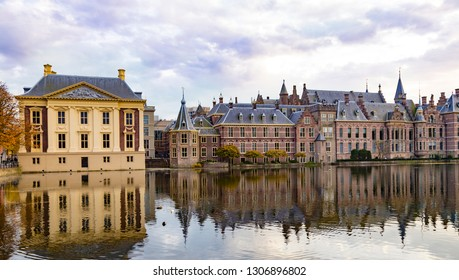 City The Hague ( Den Haag ). Historical Parliament building  Binnenhof reflected in the water on the sky  background . General view. Famous tourism destination, tourist attraction