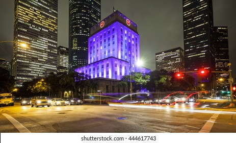 City Hall building and traffic at night in downtown Houston, Texas