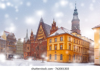 City hall and colorful houses on Market Square in the winter sunny morning in Wroclaw, Poland