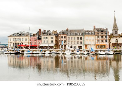 City hall (Hotel de Ville on the left), restaurants and shops at picturesque old port and harbour of Honfleur in Normandy region of France