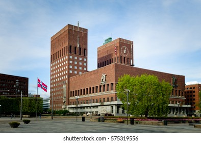 City Hall in Oslo, Norway, with Norwegian flags. Springtime.