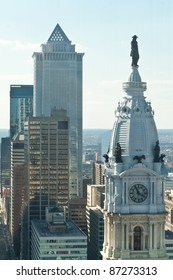 City Hall  with a statue of William Penn and tall buildings of downtown Philadelphia.  For many years there was an agreement to not allow any building to be taller then William Penn's hat.