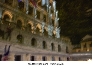 City Hall toledo reflected in the water, Night tourism, impressionist photography at low speed and with camera movement to give a surreal feel to the scene,