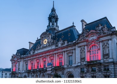 City Hall of Tours France is lighted with Red Lights in the Early Morning Sunrise.