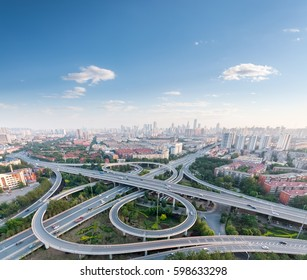 city highway interchange with blue sky, aerial view of modern traffic background