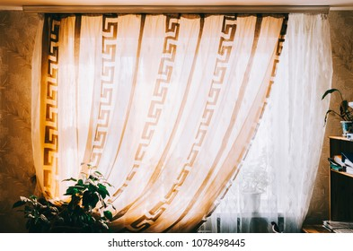 City home room window with curtains