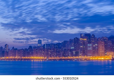 City of Hong Kong with water front with sunrise sky background
