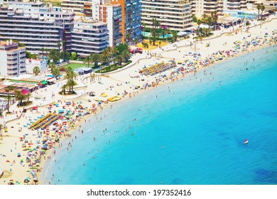 City with hotels and beach with people under the sun (Costa Brava - Spain)