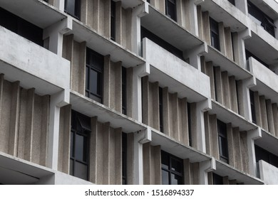 City housing, concrete apartment building with tinted windows, horizontal aspect