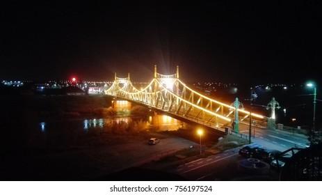 a city illuminated bridge in the night