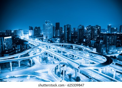 city interchange with blue tone , expressway and viaducts in chengdu at night