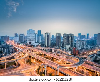 city interchange in nightfall, beautiful chengdu skyline with overpass background