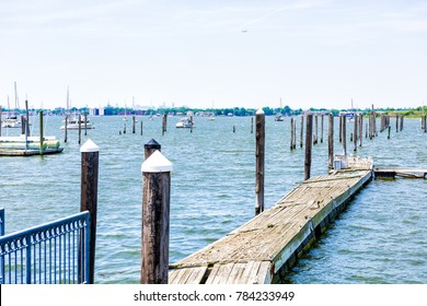 City Island harbor in Bronx, New York with boats and pier, Manhattan skyline or cityscape in distance