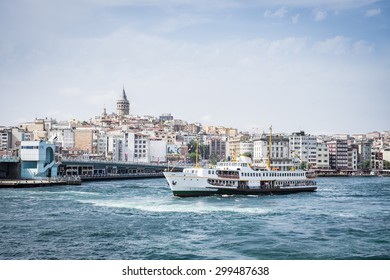 The city of Istanbul, with Galata Tower and cruise ship along bosphorus straight