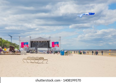 City Jurmala, Latvian Republic. Tourists and concert hall on baltic sea beach. Peoples walking. Travel photo. 2019. 25. May