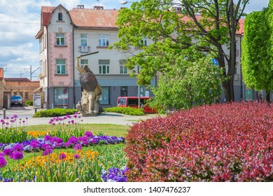 City Jurmala, Latvian Republic. Urban street view with monument and buildings. 2019. 25. May