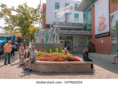 city of kamloops downtown, BC, Canada. 2019 August 10. TNRD Civic building, Kamloops Public Library, art gallery entrance, wildfire volunteers monument statue.